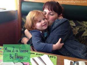 miss z is gonna be three mama kissing z