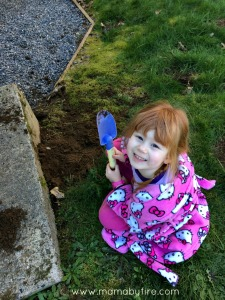 Easy garden markers toddler digging in the dirt