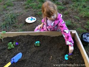 Easy garden markers toddler placing garden markers